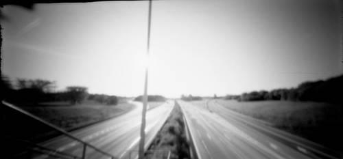 Pinhole + highway by SantaClausHell