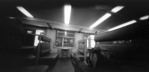 Pinhole + train by SantaClausHell