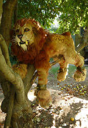 Sabertooth Lion in a tree by LilleahWest
