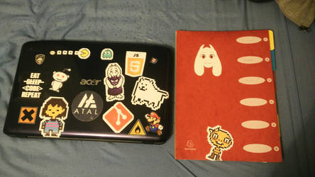 My laptop + drawing folder stickers by Tagpower