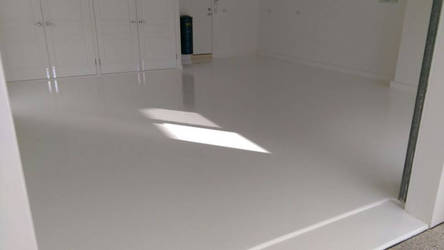 Garage high gloss white epoxy flooring by superiorconcrete