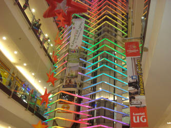 Colorful glass elevator shaft at BG Junction by rezatanaka
