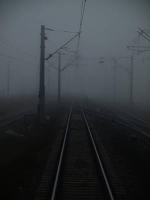 Foggy railway by dreamlikestock