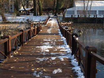 snowy bridge by dreamlikestock
