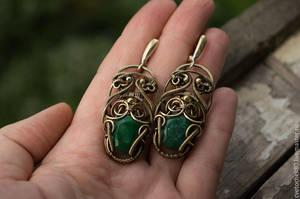 Symmetrical earrings with emeralds by DARiyaKUTEPOVA