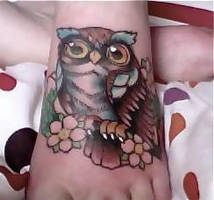 Owl tattoo by Catinmyhat