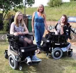 quadriplegic sisters with leg harness by dfleich