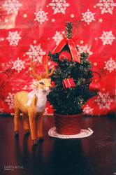 Deer by the christmas tree by Happysmitten
