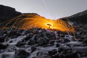 Steel wool lights on a waterfall by reinispavils
