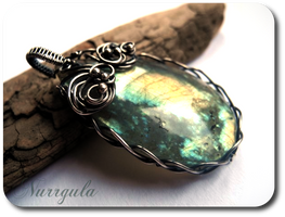Labradorite and silver pendant by nurrgula