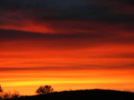 sunset over the hills by sunbeamfireking