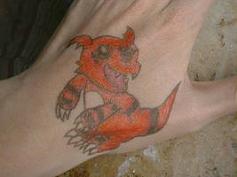 There's a Guilmon on my hand by NemoXIV