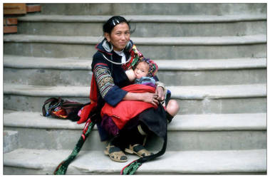 Hmong women breastfeeding by chaos-kaizer