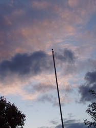 Evening sky with flagpole by Elliesmeria