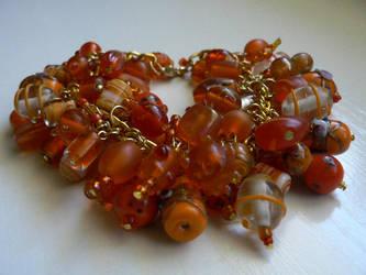 Orange beaded bracelet by luthienblack