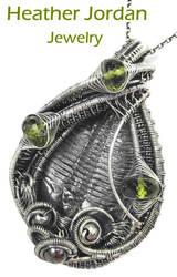 Trilobite and Peridot Pendant in Sterling Silver by HeatherJordanJewelry