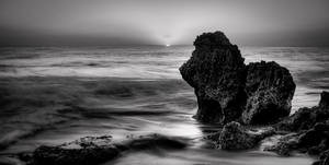 Stone lion by the sea BW by DostorJ