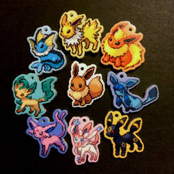 8 Bit Eeveelutions Acrylic Charms by honeyheavenly