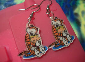 Calvin and Hobbes earrings by estranged-illusions