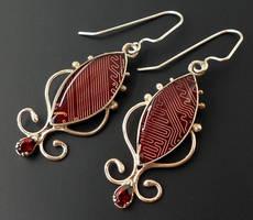 Garnet earrings by thebluekraken