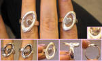 Still Alive Portal themed engagement rings by fairyfrog