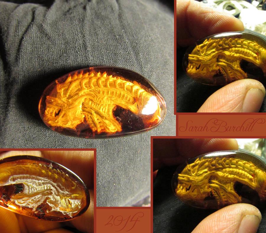 Alien Warrior amber carving by fairyfrog