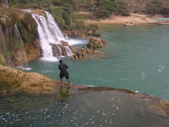 Old man fishing at waterfall by Alf-arobase