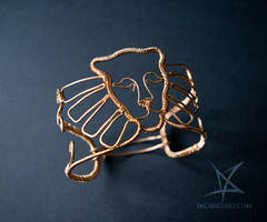 Winged lioness armlet by MissAnnThropia