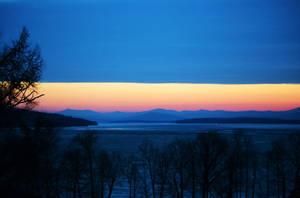 Sunrise on Frozen Champlain by rongiveans