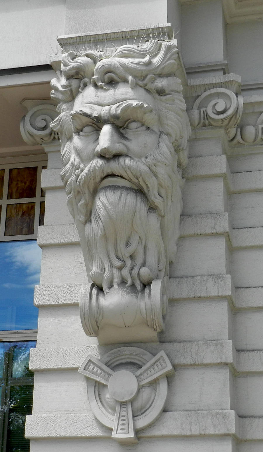 Stone Carved Man Face on Building by EveyD