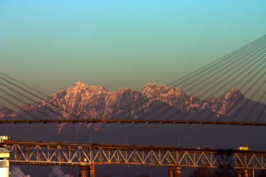 Mountains through a Bridge by ChristophMaier