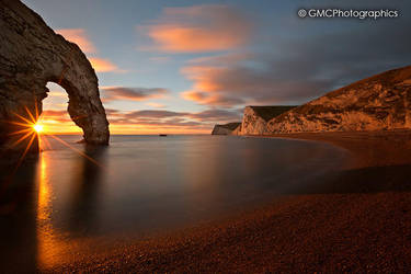 Durdle Door Sun Star by GMCPhotographics