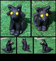 Black Wolf Sitting by AuroraStars