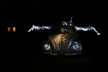 Bug with wings of light by outlawalice