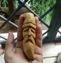 my first wood carving dude by TheAcciuga