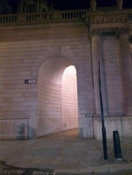 Empty building passage at night by rkibria