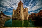 Castello Scaligero under clouds by Hermetic-Wings