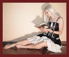 Alice reads a book 1 by Lisajen-stock