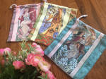 Ladies of the Months Drawstring Bags by AngelaSasser