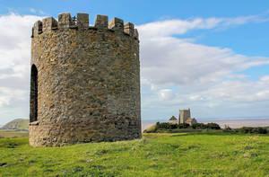 Uphill Church and castle by Vitaloverdose