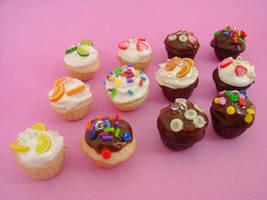 Cutesy Teeny Gourmet Cupcakes by monsterkookies