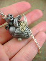 Winged Antique Silver Heart - Front by monsterkookies