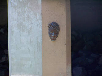 Face In Stone by xiapathos