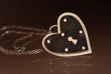 Riveting Heart Necklace by xodropdeadox