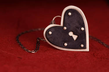 Riveting Heart Necklace on Red by xodropdeadox