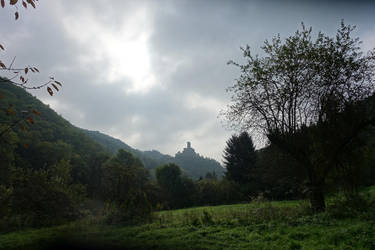 Castle in a dark valley by s8472