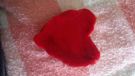 red candle wax heart by taull01