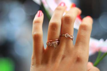 love rings by NicoleHerskowicz