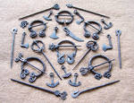 Steel brooches and pendants 2 by Astalo