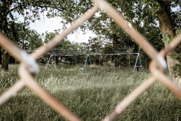 Abandoned prison yard swingset by AaronsLens